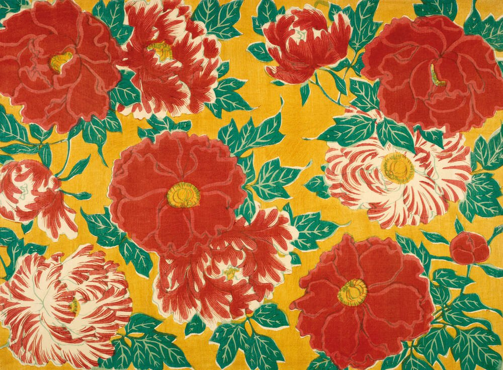 Red floral & green foliage on a yellow background